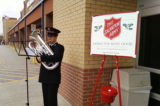 Secret Santa Drops Gold in Salvation Army Collection Kettles